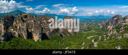 Panoramic view over the spectacular massive rocky pinnacles of Meteora, Thessaly, Greece - Stock Photo