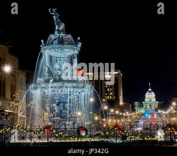 Christmas lights and Court Square fountain in downtown Montgomery, Alabama USA at night. - Stock Photo