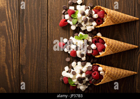 Ingrediens for smore's dessert in a waffle cone - Stock Photo