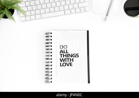 flat lay with do all things with love motivational quote in diary, computer mouse and keyboard isolated on white - Stock Photo