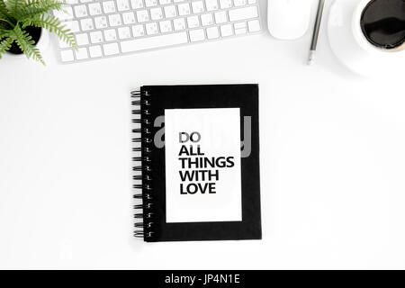 Top view of do all things with love motivational quote, computer mouse and keyboard isolated on white - Stock Photo