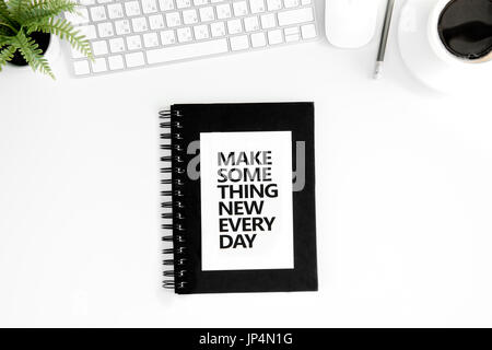 Top view of make something new everyday motivational quote, computer mouse and keyboard isolated on white - Stock Photo