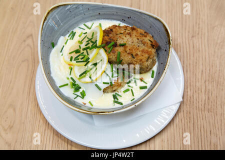 Fish cakes served with a fried egg at the Square Chapel Arts Centre in Halifax, England. The cafe serves modern - Stock Photo