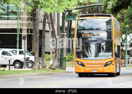 Honolulu, Hawaii - May 25, 2016: Pink Line Waikiki Trolley Bus. The Waikiki Trolley transport system  is the easy, - Stock Photo