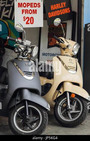 Honolulu, Hawaii, USA - May 25, 2016: Mopeds for hire in downtown Waikiki - Stock Photo