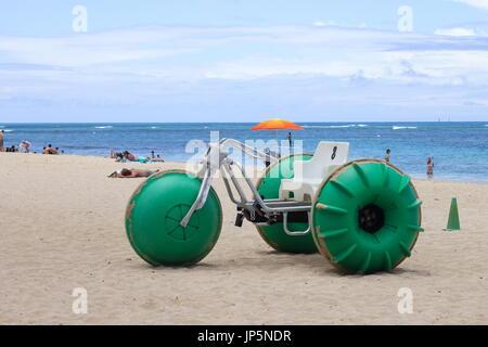 Honolulu, Hawaii, USA - May 25, 2016: Aqua-Cycle Water Trike for rent on Waikiki Beach. - Stock Photo