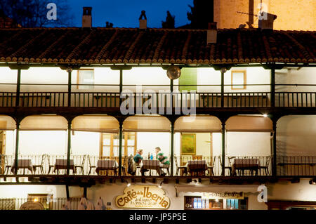 Typical meson in Plaza Mayor, night view. Chinchón, Madrid province, Spain. - Stock Photo