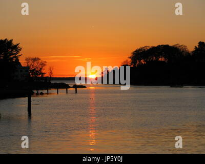 Sun setting over Tucks Point, Manchester-by-the-Sea - Stock Photo