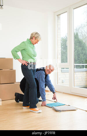 Senior couple furnishing their new apartment Stock Photo, Royalty ...