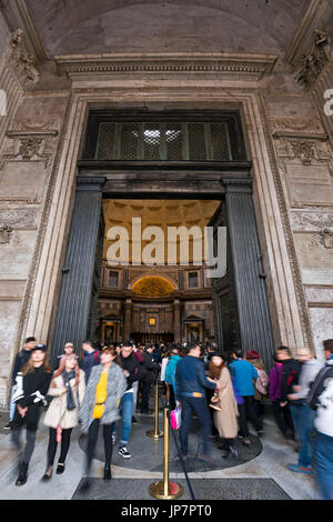 Vertical view of tourists coming and going at the doorway of the Pantheon in Rome. - Stock Photo