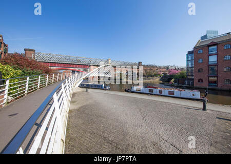 Wide view of Castlefield Basin, Manchester's industrial heritage heart on a sunny morning - Stock Photo