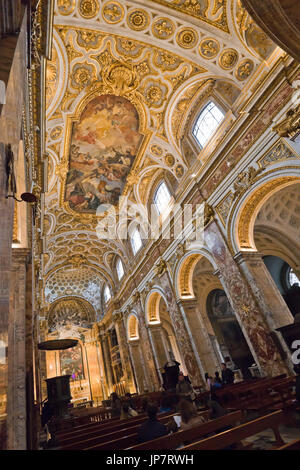 Vertical view of the high painted ceiling inside Chiesa di San Luigi dei Francesi in Rome. - Stock Photo