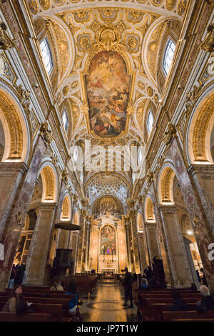 Vertical view of the high painted ceiling inside Chiesa di San Luigi dei Francesi in Rome.