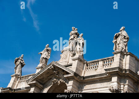 Horizontal close up view of the statues adorning the roof of Basilica di Santa Maria Maggiore in Rome. - Stock Photo