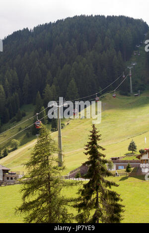 The Ciampinoi Gondola in the village of Selva or Wolkenstein at the head of The Val Gardena the Dolomites South - Stock Photo