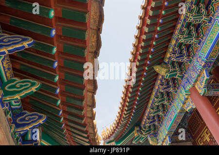 Closeup showing intricate design of roof and eaves of Summer Palace building in Beijing China - Stock Photo
