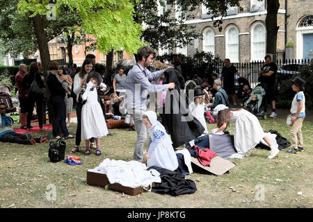 Families dress up in Victorian costumes at Annual Garden Fete Compton Terrace Gardens near Upper Street Islington - Stock Photo