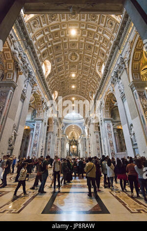 Vertical view of tourists inside St Peter's Basilica at the Vatican in Rome. - Stock Photo