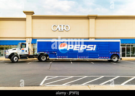 A semi Pepsi Cola delivery truck parked in the parking lot of a strip mall in Oklahoma City, Oklahoma, USA. - Stock Photo