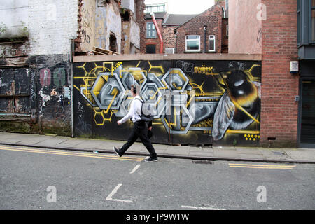 Street art by Russell Meeham who is known as Qubek in the Northern Quarter of Manchester city centre - Stock Photo