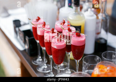 Strawberry alcoholic cocktail drinks and fruit. - Stock Photo