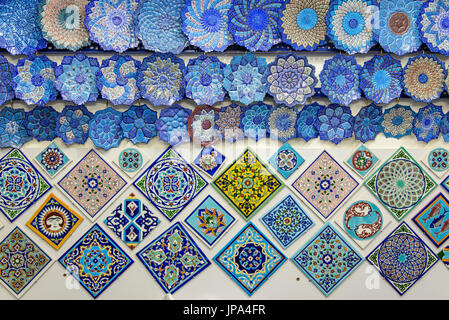 ISFAHAN, IRAN - OCTOBER 18, 2014: glazed tiles and iranian souvenirs in the Bazaar of Isfahan - Stock Photo