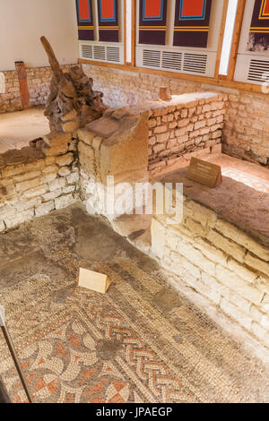 England, Gloucestershire, Cotswolds, Chedworth Roman Villa, The Bath House Mosaic Flooring - Stock Photo