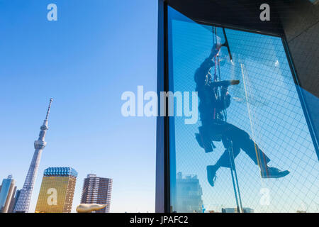 Japan, Honshu, Tokyo, Asakusa, Tokyo Sky Tree and Window Cleaner - Stock Photo