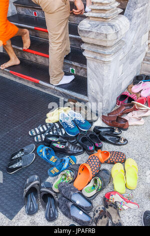 Thailand, Bangkok, Grand Palace, Wat Phra Kaeo, Visitors Shoes at the Entrance of the Temple of the Emerald Buddha - Stock Photo