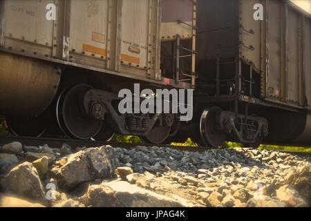 Freight train hauling and rumbling towards Seattle,. - Stock Photo