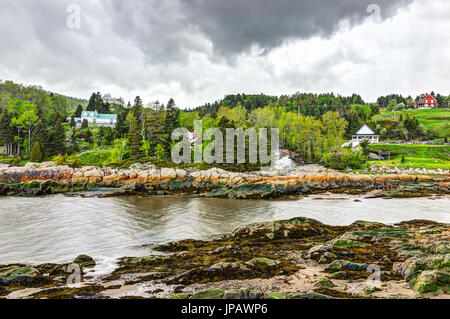 Port-au-Persil cityscape in Quebec, Canada Charlevoix region during stormy rainy day with Saint Lawrence river - Stock Photo