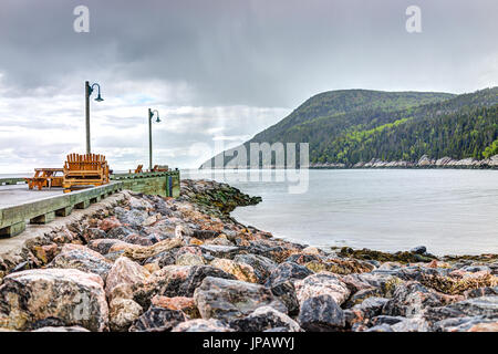 Port-au-Persil pier in Quebec, Canada Charlevoix region during stormy rainy day with Saint Lawrence river - Stock Photo
