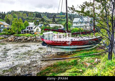 Port-au-Persil, Canada - June 2, 2017: Pier and harbor with red ship and sign La Toison D'Or in village of Quebec - Stock Photo