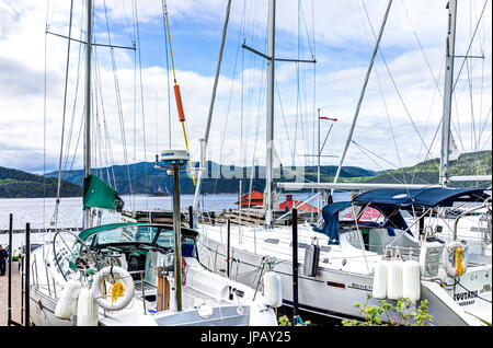 L'Anse-Saint-Jean, Canada - June 2, 2017: Closeup of boats in harbor in Quebec village by Saguenay fjord river - Stock Photo
