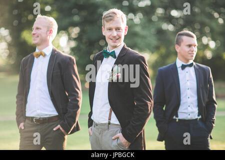 Bridegroom and groomsman outside, half portrait - Stock Photo