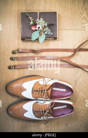 men's shoes, braces, flowers and book, Still life - Stock Photo