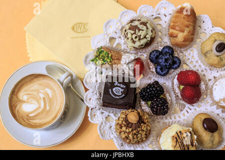 Cappuccino with typical sweets and pastries in the old Cafe Cova icon of Milan Lombardy Italy Europe - Stock Photo