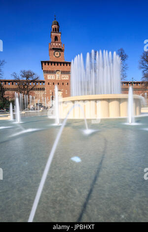 The fountain frames the ancient Sforza Castle Milan Lombardy Italy Europe - Stock Photo