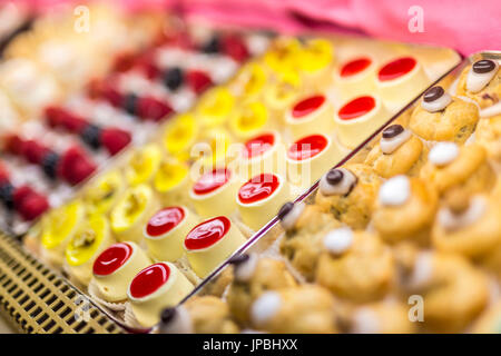 Typical homemade sweets and pastries of the old Cafe Cova icon of Milan Lombardy Italy Europe - Stock Photo