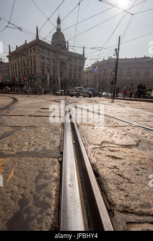 The rails of the old tram in the streets of the historical city center Milan Lombardy Italy Europe - Stock Photo