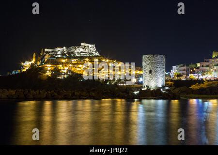 Night view of village on promontory and its medieval tower Castelsardo Gulf of Asinara Province of Sassari Sardinia - Stock Photo