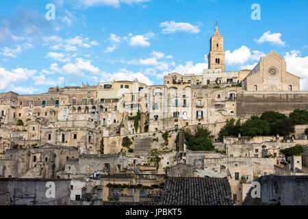 Typical houses and churches in the historical center called Sassi perched on rocks on top of hill Matera Basilicata - Stock Photo