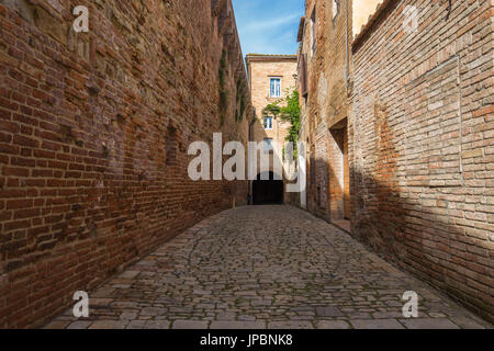 Paved way inside the walls of the historic center of Buonconvento.  Buonconvento, Ombrone valley,Crete senesi, Siena - Stock Photo