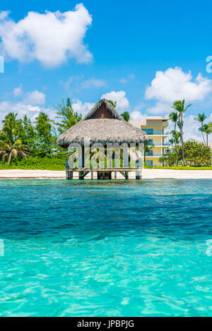 Playa Blanca, Punta Cana, Dominican Republic, Caribbean Sea. Thatched hut on the beach. - Stock Photo
