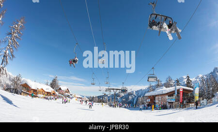 a fisheyed view of the Folgarida ski resort with a lot of tourists on the slopes, Trento province, Trentino Alto - Stock Photo