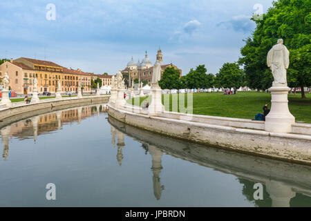 Statues reflect in the elliptical canal surrounding the gardens on Prato della Valle, Padua, Veneto, Italy on a - Stock Photo