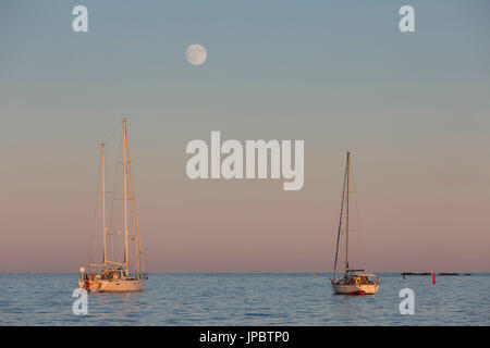 Mooring aailboats during the sunset (Lerins Islands, Cannes, Grasse, Alpes-Maritimes department, Provence-Alpes - Stock Photo