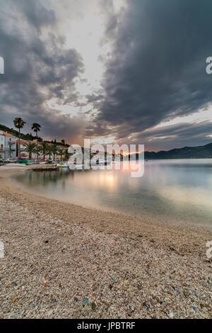 Sunset from the beach of Korcula village (Korcula, Korcula Island, Dubrovnik-Neretva county, Dalmatia region, Croatia, - Stock Photo