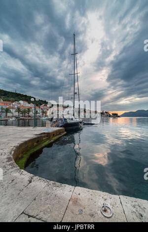 Sunset from the port of Korcula village (Korcula, Korcula Island, Dubrovnik-Neretva county, Dalmatia region, Croatia, - Stock Photo