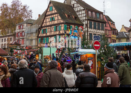 Tourists and Christmas Markets in the old medieval town of Colmar Haut-Rhin department Alsace France Europe - Stock Photo